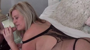 Heather C Payne giving a blowjob in a sexy black fishnet lingerie