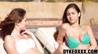 Lesbian sluts Ellena and Nina have steamy sex by the pool