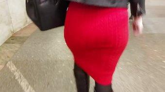 Ass in red skirt