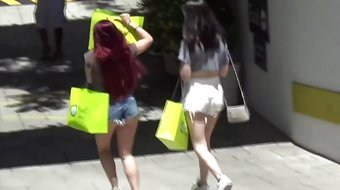 Ariel Winter wearing short shorts while shopping