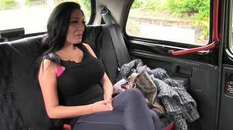 Huge tittied brunette in fake taxi