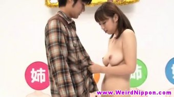 Young japanese beautie drooling on two dicks