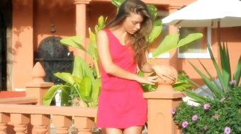 Gorgeous woman in red teasing outdoors