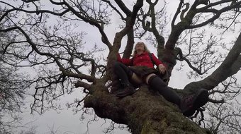 Lisa rubbing her pussy in a tree