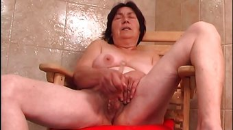 Over 70 granny with hairy pussy fucks a dildo