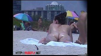 A couple of women walking on a nude beach