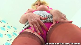 British milf Lucy Gresty slides a finger up her arse