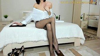 Elegant legs of a slim lady in nylon pantyhose.