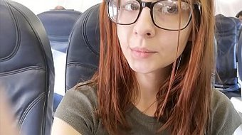 Cute pornstar fingers herself in airplane bathroom